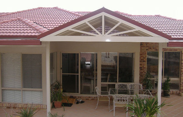 All seasons patios home addition gable roof pitched for Gable roof addition